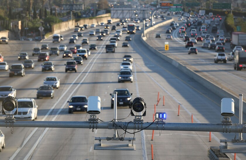 Cameras and electronic sensors stand over the toll lanes south of the Slauson Ave. transit station on the 110 Freeway.