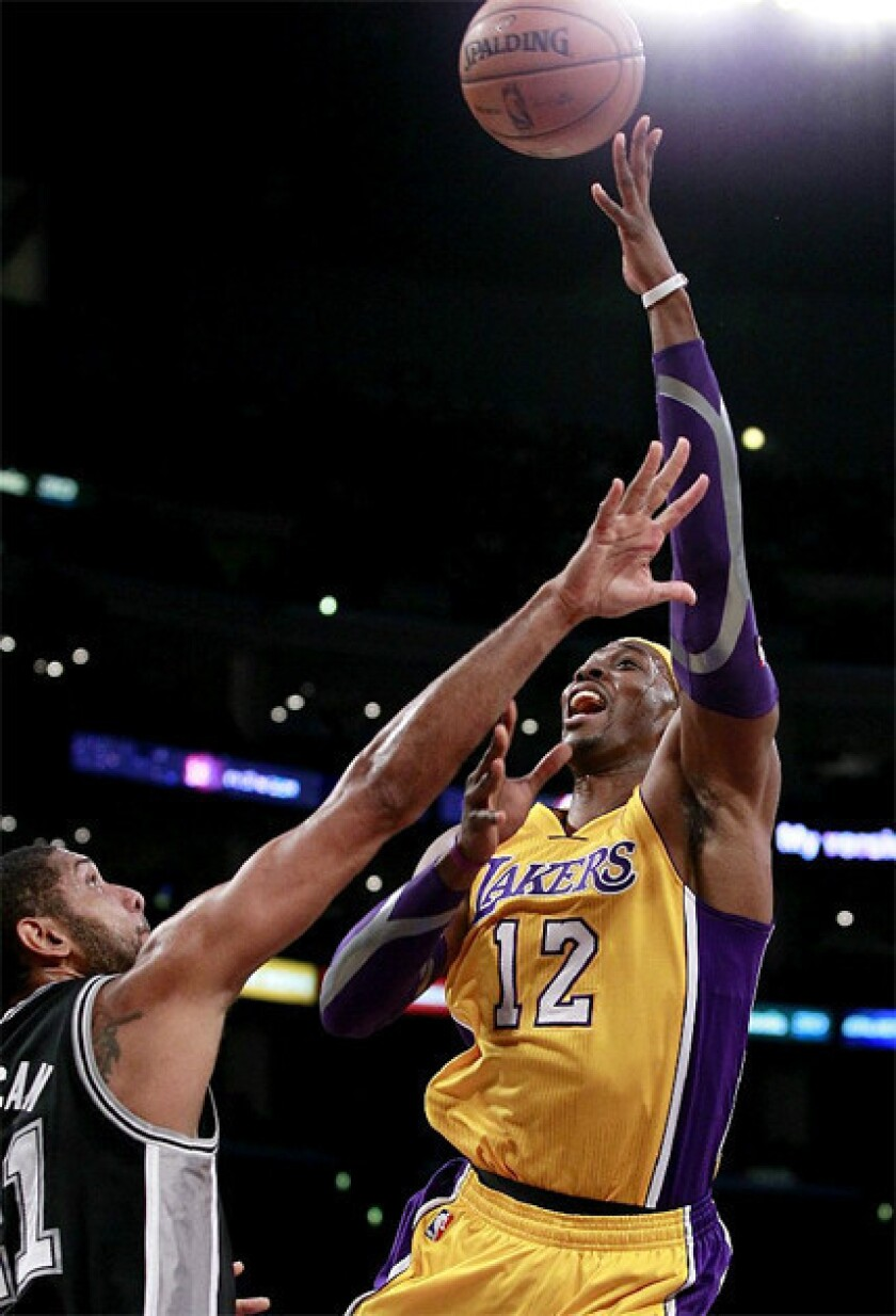 Dwight Howard shoots over Tim Duncan in the Lakers match-up against the Spurs.