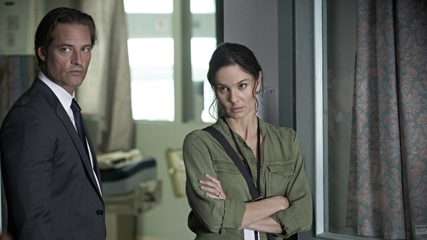 "Josh Holloway and Sarah Wayne Callies in ""Colony"" on USA."