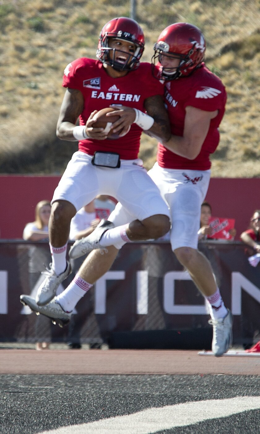 Eastern Washington quarterback Vernon Adams, left, celebrates his touchdown with wide receiver Cooper Kupp against Idaho State during the first quarter of an NCAA college football game Saturday, Oct. 4, 2014, in Cheney, Wash. (AP Photo/The Spokesman-Review, Dan Pelle)