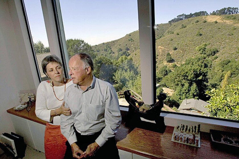 HOMEOWNERS: Peter Scott and Teresa Ferguson lost his mother and their home in the 1991 Oakland fire. Their insurance policy didn't have the coverage they thought it did, so rebuilding costs hit hard.