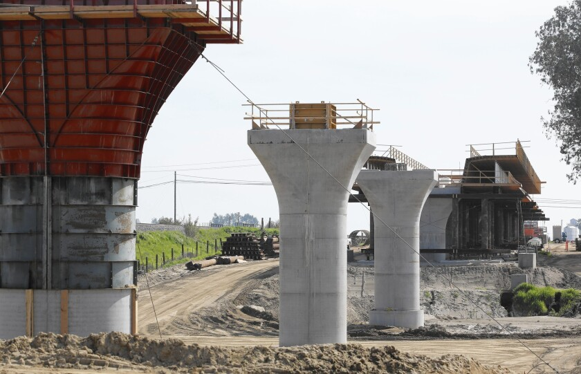 Contractors hired by the state have begun building supports for a bullet train viaduct near Madera in the Central Valley.