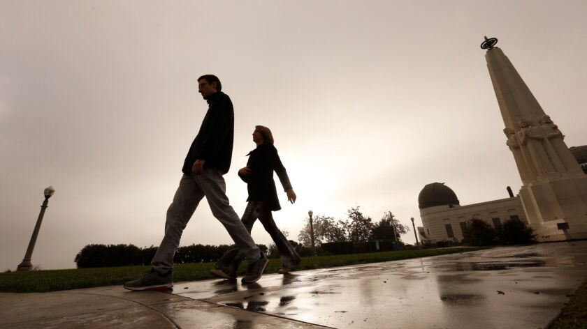 Scattered showers are likely in Los Angeles through Wednesday, but the light rains won't do much to alleviate a dry start to the year, forecasters say. The last big rain in L.A. occurred in November, as seen here at Griffith Observatory.