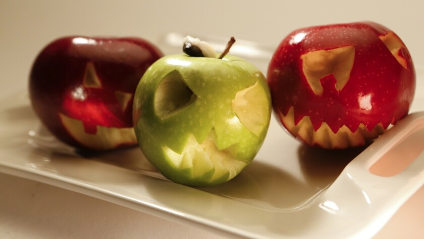Carved fruits and veggies as jack-o'-lanterns