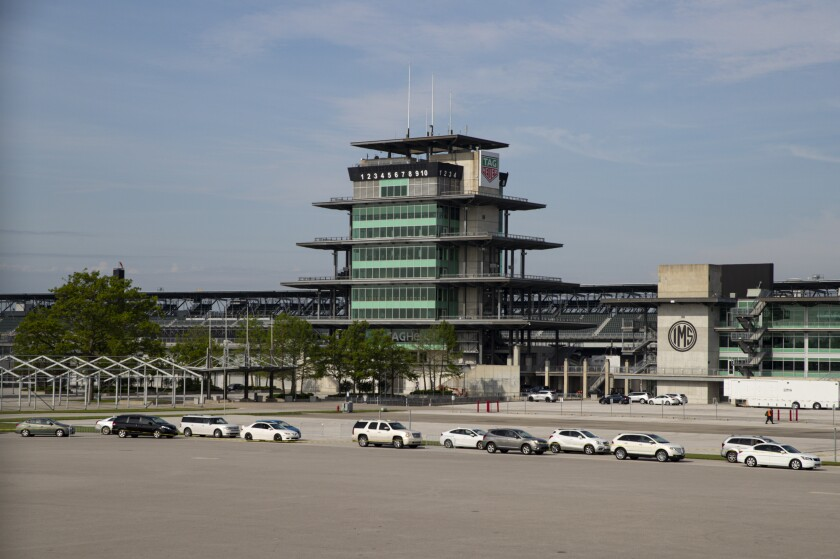 Vehicles line up at Indianapolis Motor Speedway on May 23, 2020, for a mobile food distribution event.