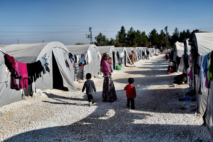 A Syrian mother and her children are among those living at a refugee camp in the Turkish town of Suruc on Nov. 12, 2014.