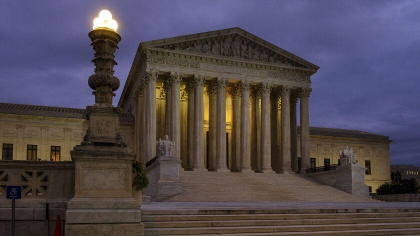 The U.S. Supreme Court building before dawn in Washington.