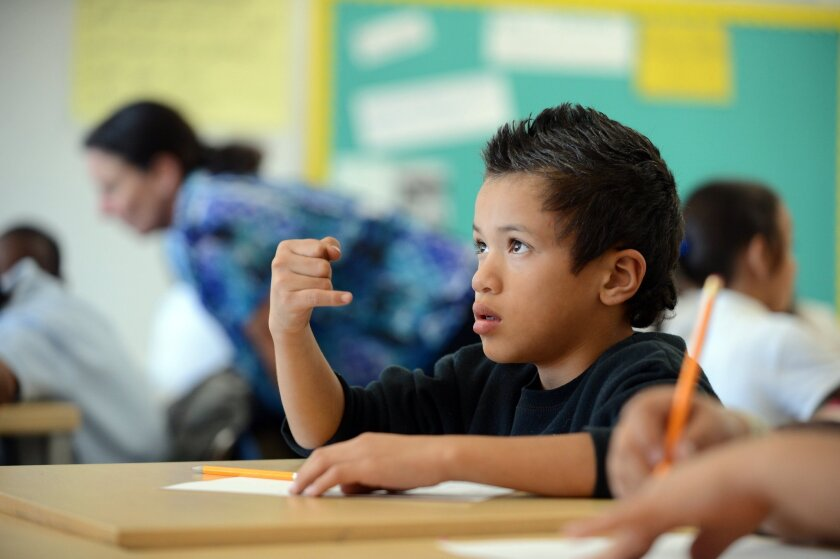 A fourth-grader works on a math problem at Montalvin Manor Elementary School in San Pablo.