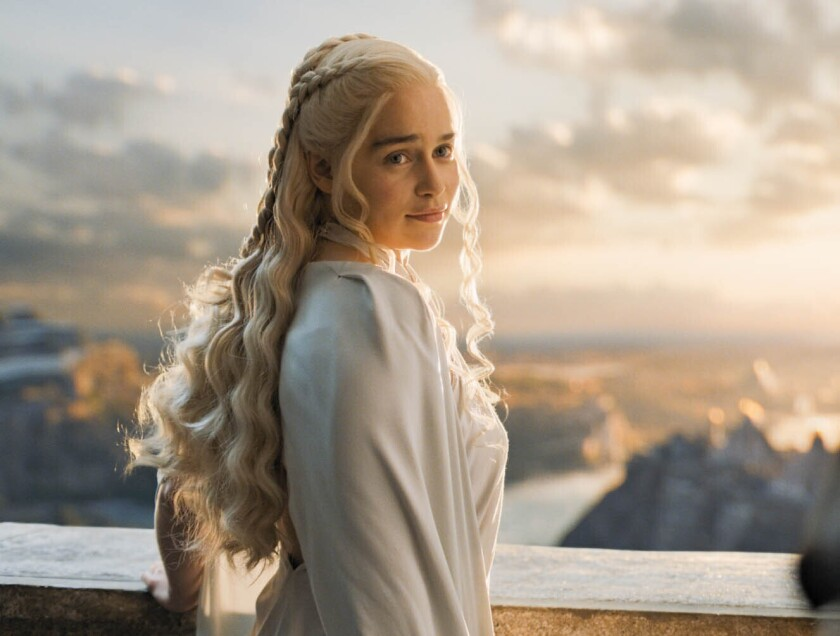 """In this image released by HBO, Emilia Clarke portrays Daenerys Targaryen in a scene from """"Game of Thrones."""" In the hands of Emilia Clarke, Dany went from a young girl sold into marriage into a fierce, stately queen. She ruled multiple cities, freed thousands of slaves, build powerful armies and, finally, sat on the Iron Throne, if only briefly. Dany stunned when she hatched three dragons and saved Jon Snow from the Night King's army, prompting many Halloween costumes. But good and evil were often blurred as this fearsome woman went on the march. (HBO via AP)"""