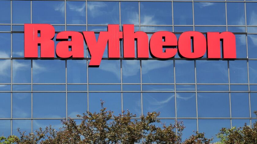 The sky is reflected on the facade of Raytheon's Integrated Defense Systems facility, Monday, June 1