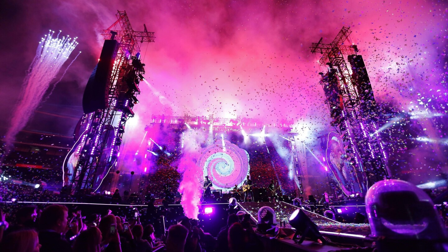Fireworks an confetti fill the air as Coldplay performs during their A Head Full of Dreams Tour at SDCCU Stadium in San Diego on Oct. 8, 2017. (Photo by K.C. Alfred/The San Diego Union-Tribune)