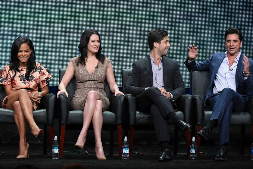 """Actors Christina Milian, from left, Paget Brewster, Josh Peck and John Stamos participate in the """"Grandfathered"""" panel at the Fox Summer TCA Tour at the Beverly Hilton Hotel on Thursday, Aug. 6, 2015, in Beverly Hills."""