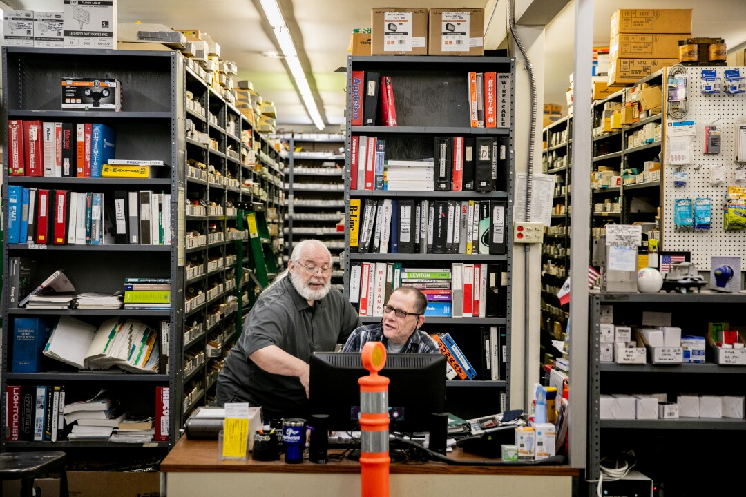 Frank May, 66, and Gene Anderson, 62, work alongside one another in the San Diego Electric store.