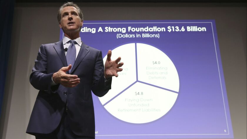 Gov. Gavin Newsom, seen presenting his first state budget on Jan. 10, will submit a revised spending plan to the Legislature this week.