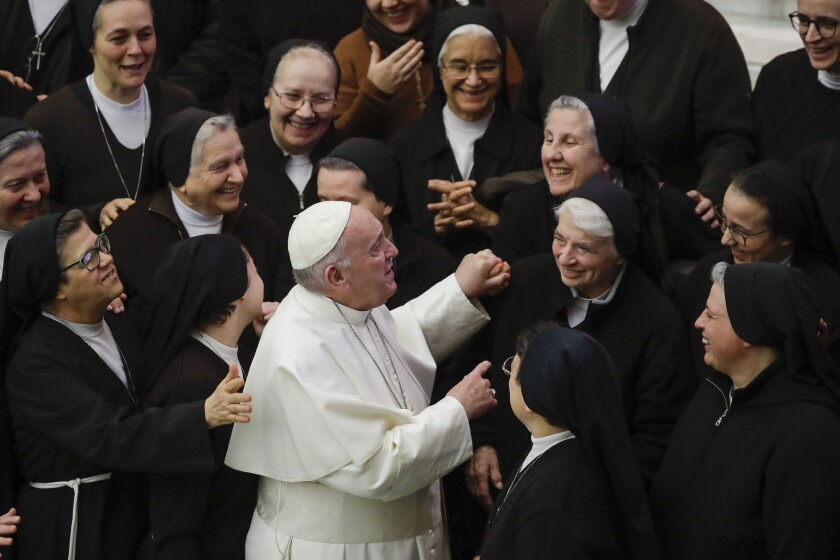 Pope Francis greets a group of nuns during his weekly general audience, in Paul VI Hall at the Vatican, on Wednesday.