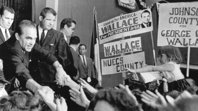 Presidential candidate George Wallace greets supporters at the Texas State convention of his American Independent Party in Dallas on Sept. 17, 1968.