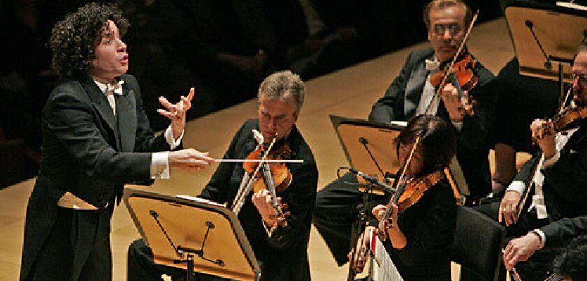 BODY LANGUAGE: Gustavo Dudamel conducts on Friday at Disney Hall in his first orchestral program as music director-designate of the Los Angeles Philharmonic.