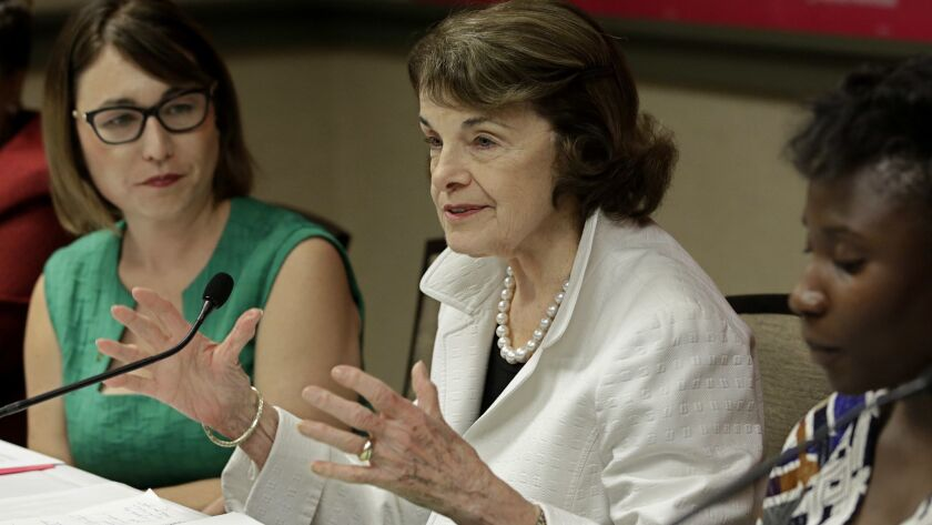 Sen. Dianne Feinstein (D-Calif.) speaks at a gathering for Planned Parenthood with Crystal Strait, left, chief executive officer and president of Planned Parenthood Affiliates of California on Thursday, May 31, in Sacramento.