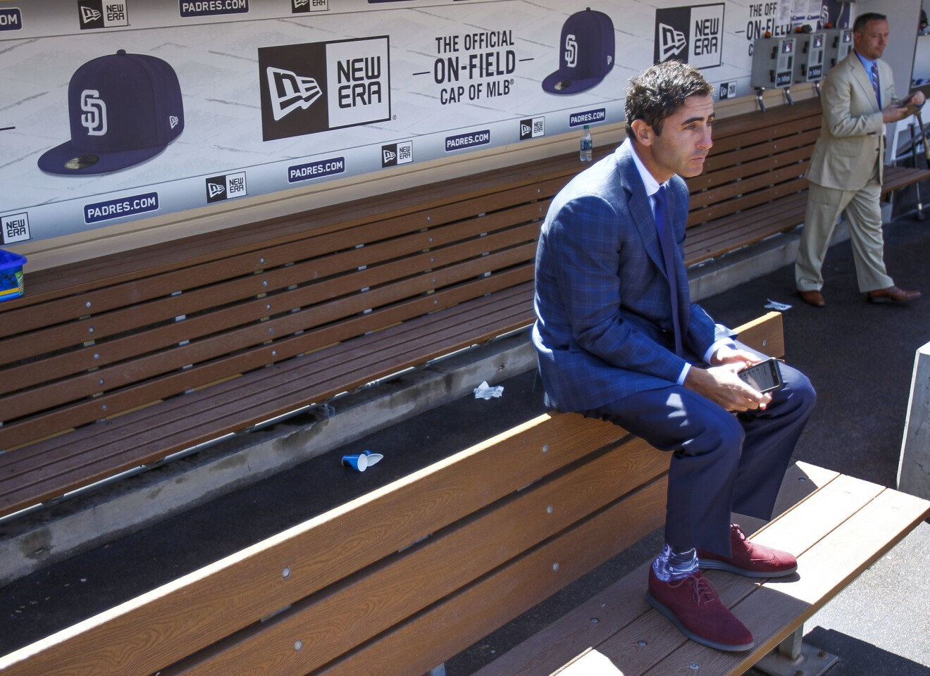 SAN DIEGO, March 29, 2018 | General manager of he Padres A.J. Preller sits in the Padres dugout before the Padres play the Milwaukee Brewers on Opening Day at Petco Park in San Diego on Thursday. | Photo by Hayne Palmour IV/San Diego Union-Tribune/Mandatory Credit: HAYNE PALMOUR IV/SAN DIEGO UNION-TRIBUNE/ZUMA PRESS San Diego Union-Tribune Photo by Hayne Palmour IV copyright 2017