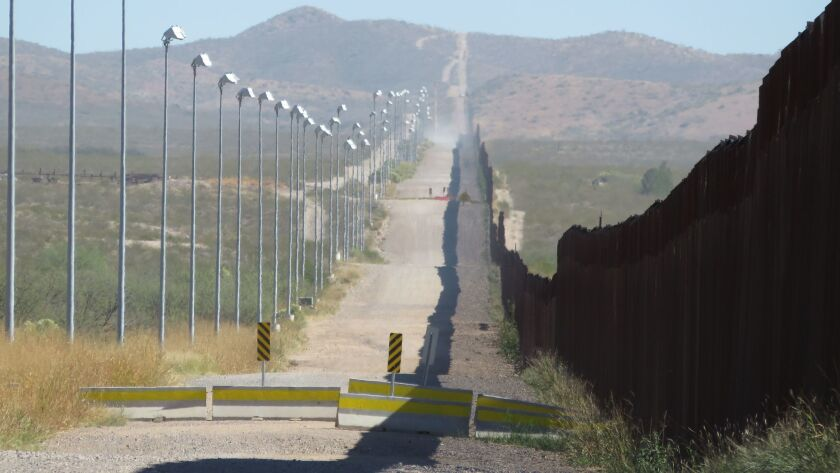 The U.S. border wall with Mexico looking east from the edge of Douglas, Ariz.