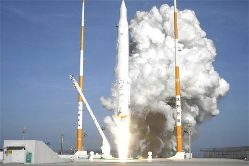 In this photo released by Korea Aerospace Research Institute, South Korea's rocket lifts off from its launch pad at the Naro Space Center in Goheung, South Korea, Wednesday, Jan. 30, 2013. South Korea says it has successfully launched a satellite into orbit from its own soil for the first time. Wed
