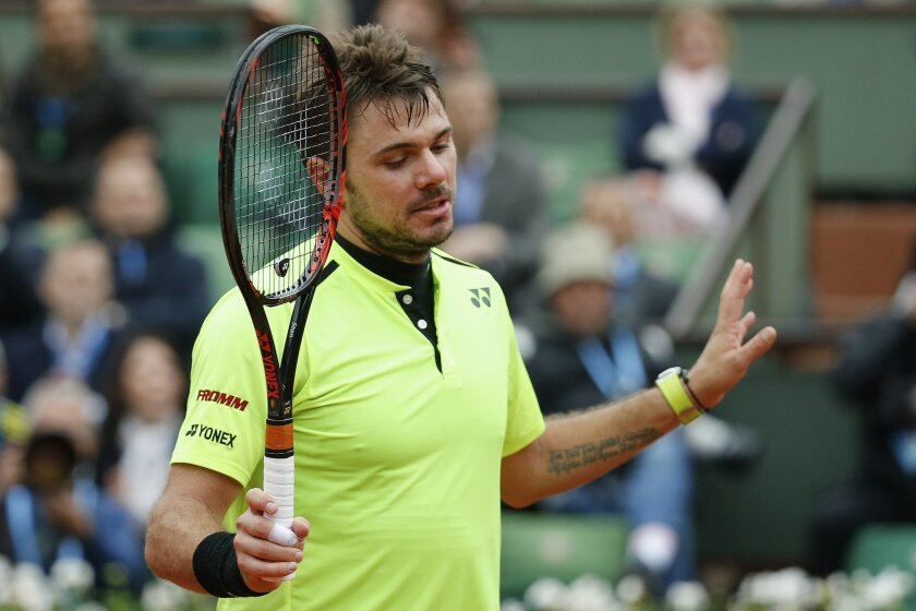 Switzerland's Stan Wawrinka apologizes for scoring with a ball which bounced off the net in his semifinal match of the French Open tennis tournament against Britain's Andy Murray at the Roland Garros stadium in Paris, France, Friday, June 3, 2016. (AP Photo/Alastair Grant)