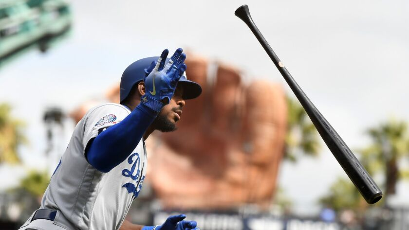 SAN FRANCISCO, SEPTEMBER 29, 2018-Dodgers Yasiel Puig flips his bat after hitting a solo home run ag