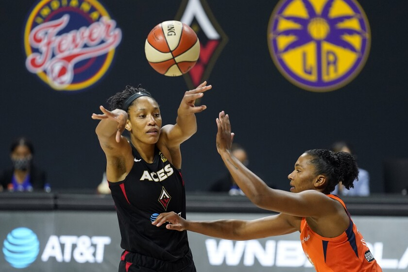 Las Vegas Aces center A'ja Wilson passes the ball in front of Connecticut Sun forward Alyssa Thomas.