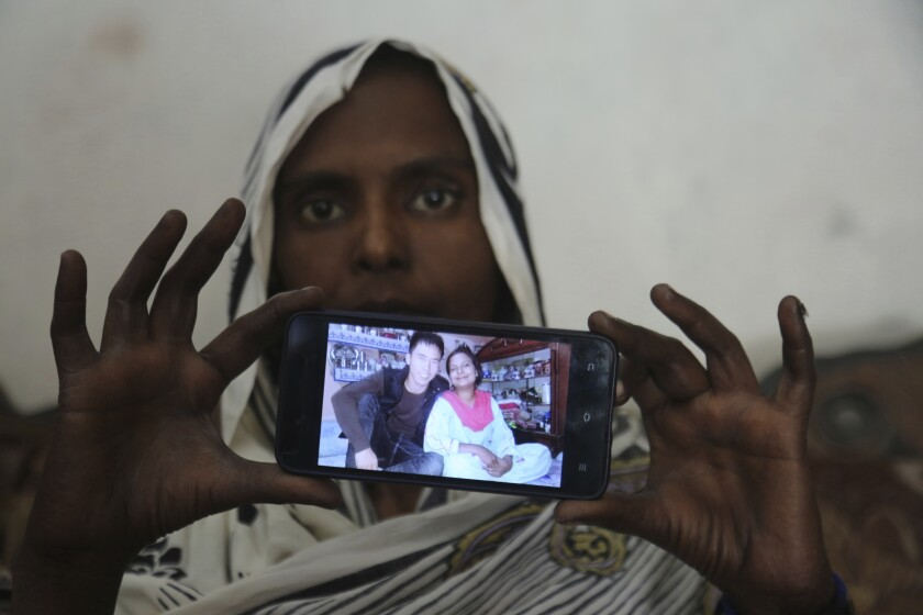 HOLD FOR TRAFFICKED BRIDES-SUSPICIOUS DEATH BY Kathy Gannon… In this April 14, 2019 photo. Pakistani Christian woman Samiya David shows her picture with Chinese husband, in Gujranwala, Pakistan. Samiya had been in China just two months when her brother got a phone call telling him to pick her up at the airport. When he arrived, he found Samiya in a wheelchair, malnourished and too weak to walk, said her cousin Pervaiz Masih. She died barely five weeks later. Masih was among the relatives who prepared Samiya's grave and attended her burial in May. (AP Photo/K.M. Chaudary)