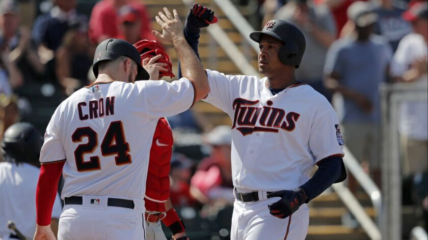 Minnesota Twins Jonathan Schoop is greeted by C.J. Cron (24) on his 2-run homer in the fifth inning