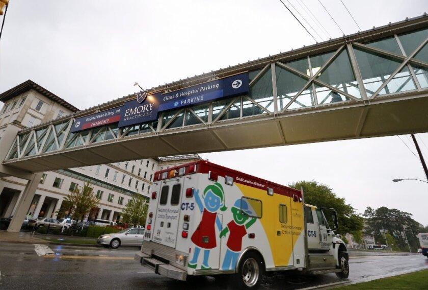 Emory University Hospital in Atlanta prepares to receive American patients sickened by Ebola in August.