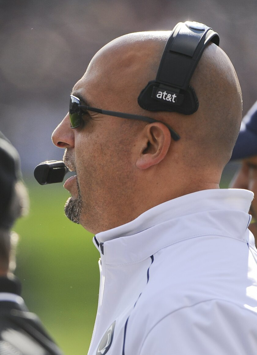 Penn State head coach James Franklin directs the team during the first quarter of an NCAA college football game against Northwestern in Evanston, Ill.,  Saturday, Nov. 7, 2015. (AP Photo/Matt Marton)
