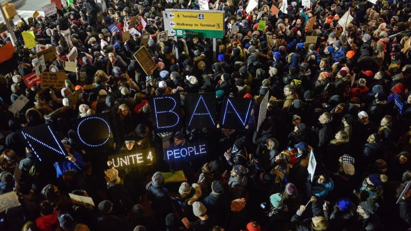 Protesters demonstrate against the Trump administration's refugee and immigration orders at John F. Kennedy International Airport on Jan. 28 in New York City.