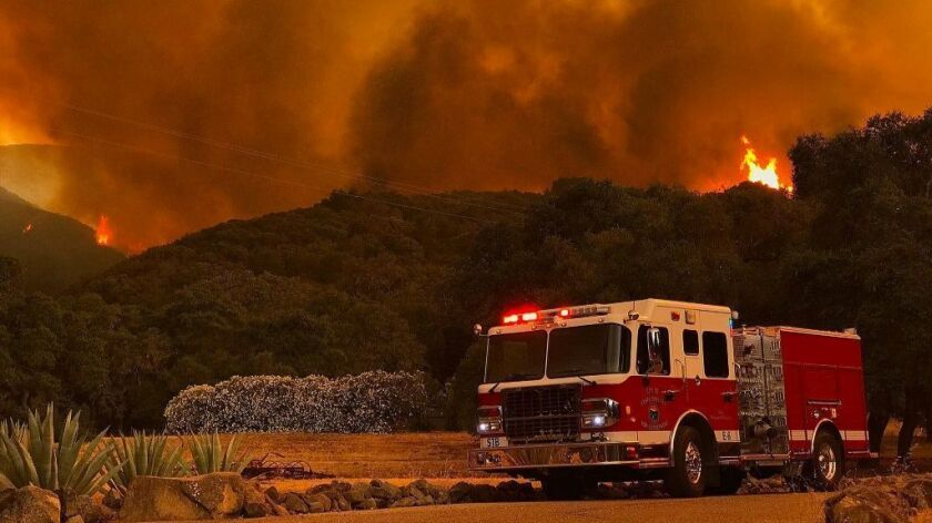 A fire engine parked along Highway 154 to protect a nearby home near the Los Padres National Forest.