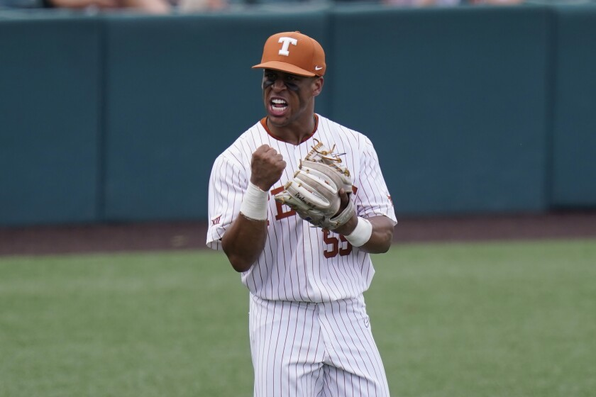 Texas third baseman Camryn Williams celebrates an out against Southern during the eighth inning of an NCAA regional tournament college baseball game, Friday, June 4, 2021, in Austin, Texas. (AP Photo/Eric Gay)