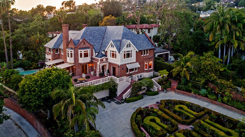 Entertainer Michael Feinstein and his husband updated and restored the Tudor Revival-style home during their two decades of ownership, converting the unfinished third floor to an entertainer's space.