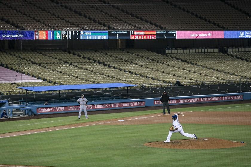 Dodgers closer Kenley Jansen delivers a pitch against the San Francisco Giants at Dodger Stadium on July 26.