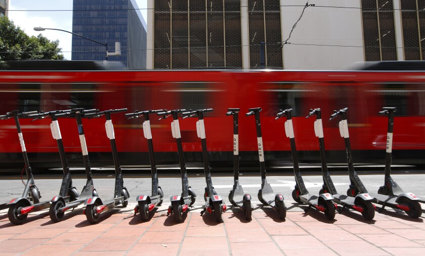 Bird scooters lined up in downtown San Diego.