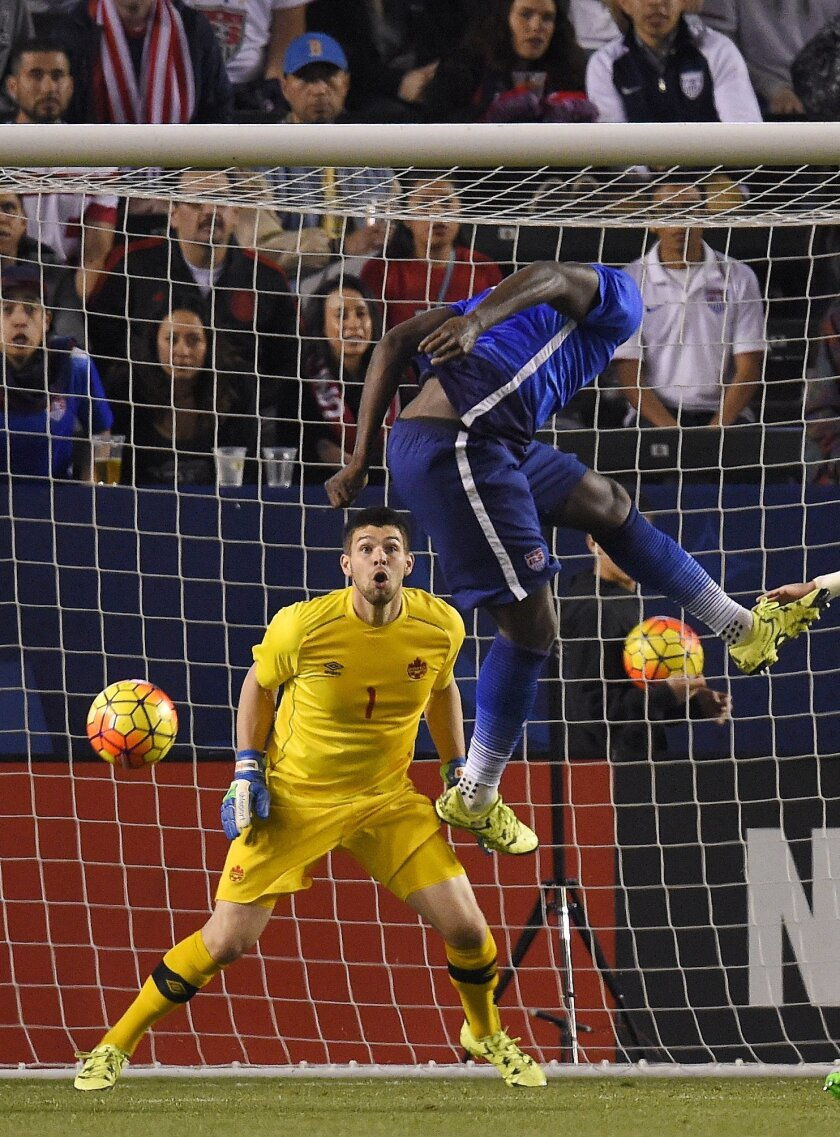 United States' Jozy Altidore, right, tires to score on Canada goalkeeper Maxime Crepeau during the second half of an exhibition soccer match Friday, Feb. 5, 2016, in Carson, Calif. The United States won 1-0. (AP Photo/Mark J. Terrill)