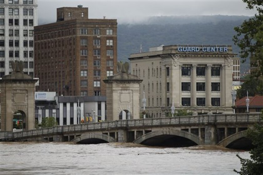 The swollen Susquehanna River rises against Market Street Bridge, Thursday, Sept. 8, 2011, in Wilkes-Barre, Pa. Widespread flooding brought on by the remnants of Tropical Storm Lee was being blamed for two deaths in Pennsylvania, where inundated communities were evacuated and state offices closed down on Thursday because of the rising waters. (AP Photo/Matt Rourke)