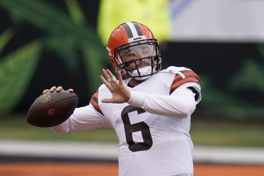 Cleveland Browns quarterback Baker Mayfield throws before an NFL football game against the Cincinnati Bengals, Sunday, Oct. 25, 2020, in Cincinnati. (AP Photo/Michael Conroy)