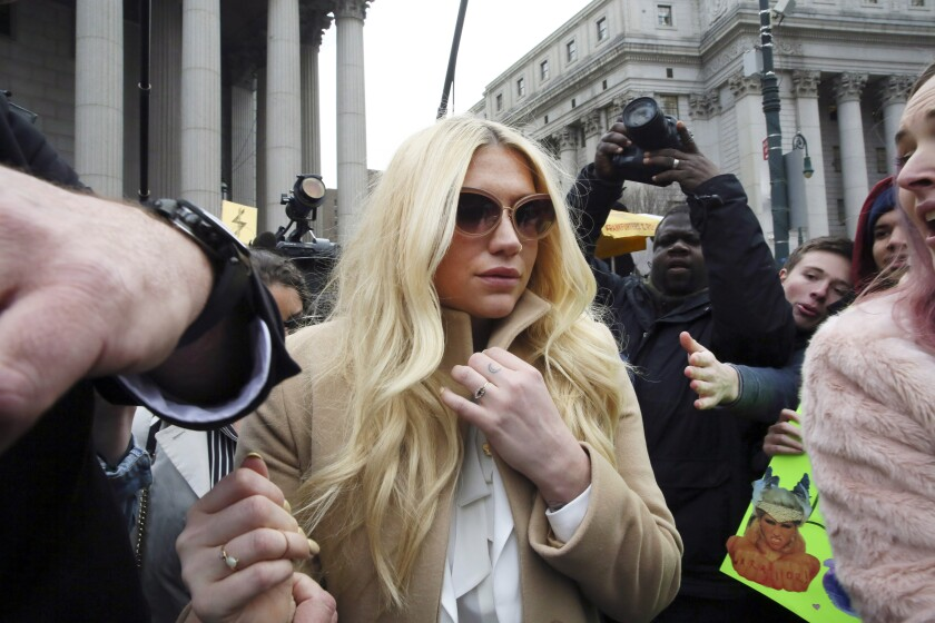 FILE - In this Feb. 19, 2016, file photo, pop star Kesha leaves Supreme court in New York after a hearing involving her producer, Dr. Luke. An appellate court ruled for music producer Dr. Luke Thursday, April 22, 2021, on an important legal question in his defamation suit against pop star Kesha, concluding that the Grammy-nominated hitmaker isn't a public figure in the eyes of the law. (AP Photo/Mary Altaffer, File)