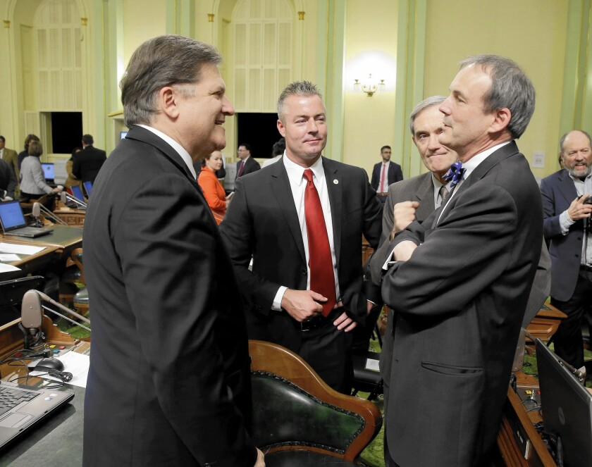 State Sen. Bob Hertzberg (D-Van Nuys), left, talks to Charles Munger Jr. in 2014; Hertzberg and Democratic state Controller Betty Yee see an opportunity to reform the tax system.
