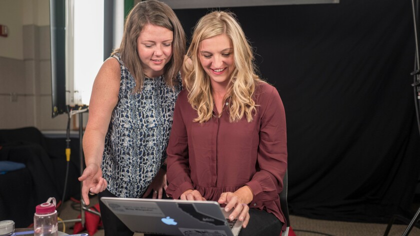 Jami Mathewson, left, and Samantha Erickson of the Wiki Education Foundation go over notes prior to an educational video they are recording at the UC San Francisco School of Medicine.