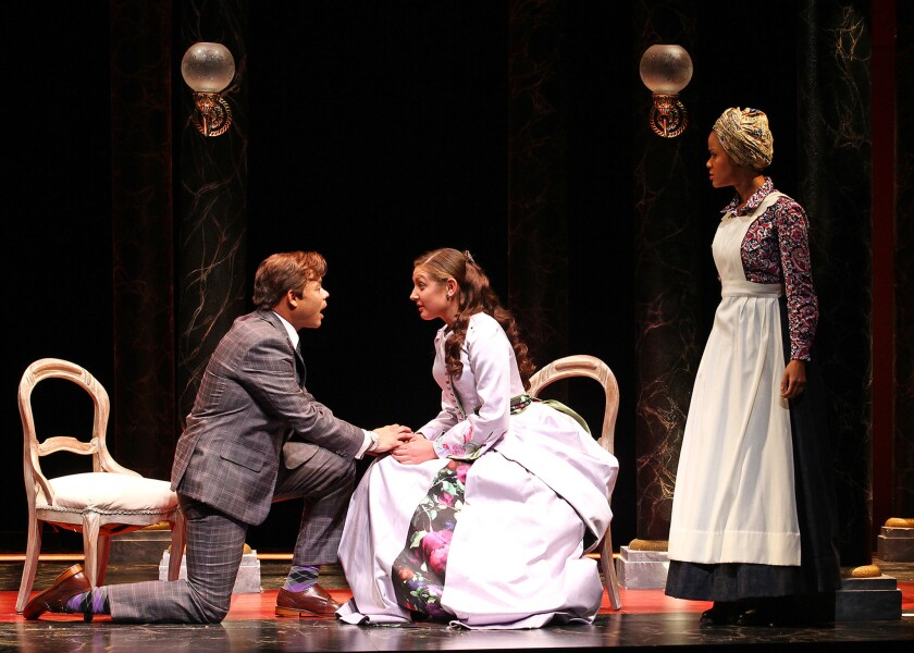 """Chris Butler, Helen Sage Howard Simpson and Kristy Johnson in South Coast Repertory's 2016 production of """"District Merchants"""" by Aaron Posner."""