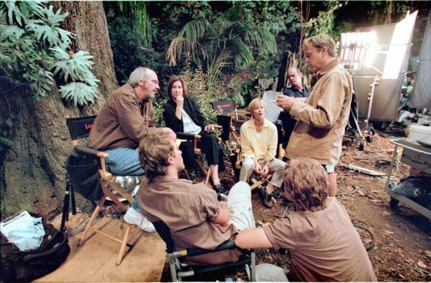 """Paleontologist Jack Horner, far left, was the advisor for the """"Jurassic Park"""" production on scientific matters and he provided inspiration for the character of Dr. Alan Grant played by Sam Neil (far right)."""