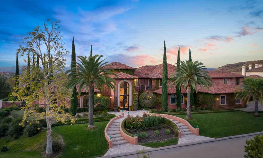 The estate centers on a 12,250-square-foot mansion with eight bedrooms, ten bathrooms, a movie theater and bowling alley.