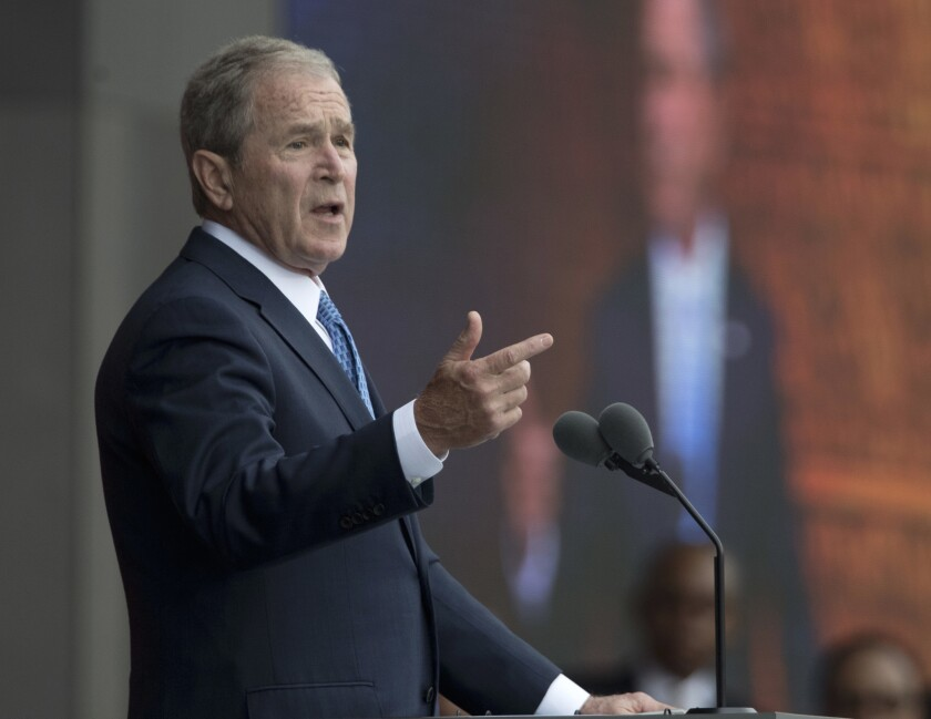 "Former President George W. Bush, shown last year, has defended the news media's role in holding world leaders accountable. ""It's important for the media to call to account people who abuse their power, whether it be here or elsewhere."""