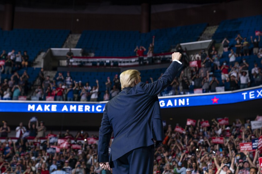 President Donald Trump arrives on stage to speak at a campaign rally in Tulsa.