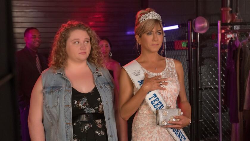 "(L-R) - Danielle Macdonald and Jennifer Aniston in a scene from ""Dumplin'."" Credit: Bob Mahoney / Ne"